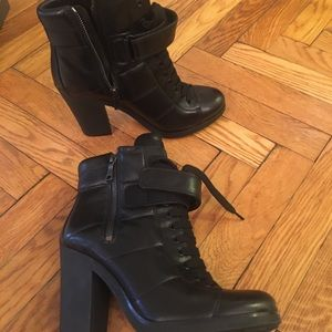 Prada leather lace-up ankle boots.